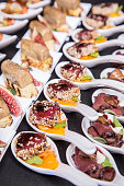 Gourmet appetizers: fois gras, figs fruit and tuna.