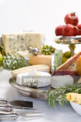 Gourmet cheeses and fruit plates : Stock Photo
