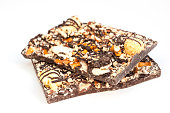 Gourmet dark chocolate with nuts, caramel, cookies, pretzels, marshmallow, and toffee