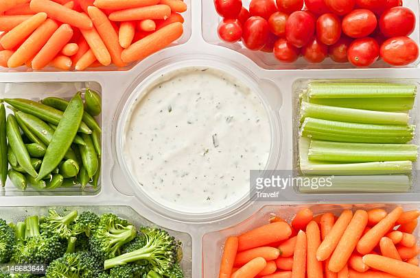 Gourmet tray with fresh vegetables and a dip
