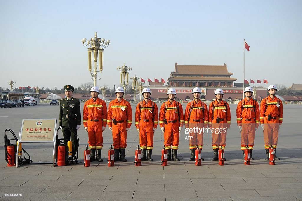 A gourp of firemen stand in line during the opening session of the Chinese People's Political Consultative Conference (CPPCC) outside the Great Hall of the People in Beijing on March 3, 2013. Thousands of delegates from across China meet this week to seal a power transfer to new leaders whose first months running the Communist Party have pumped up expectations with a deluge of propaganda. AFP PHOTO / WANG ZHAO
