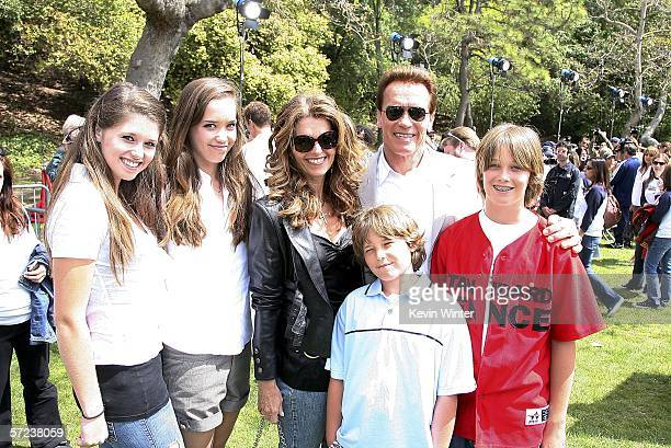 Gov Arnold Schwarzenegger and his wife Maria Shriver pose with their children Katherine Christina Patrick and Christopher at a prepremiere softball...