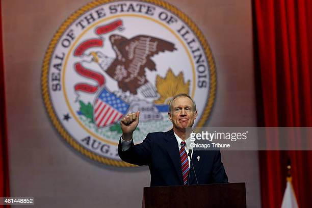Gov Bruce Rauner gives a thumbs up after giving his first speech as governor on Monday Jan 12 2015 at the Prairie Capital Convention Center in...
