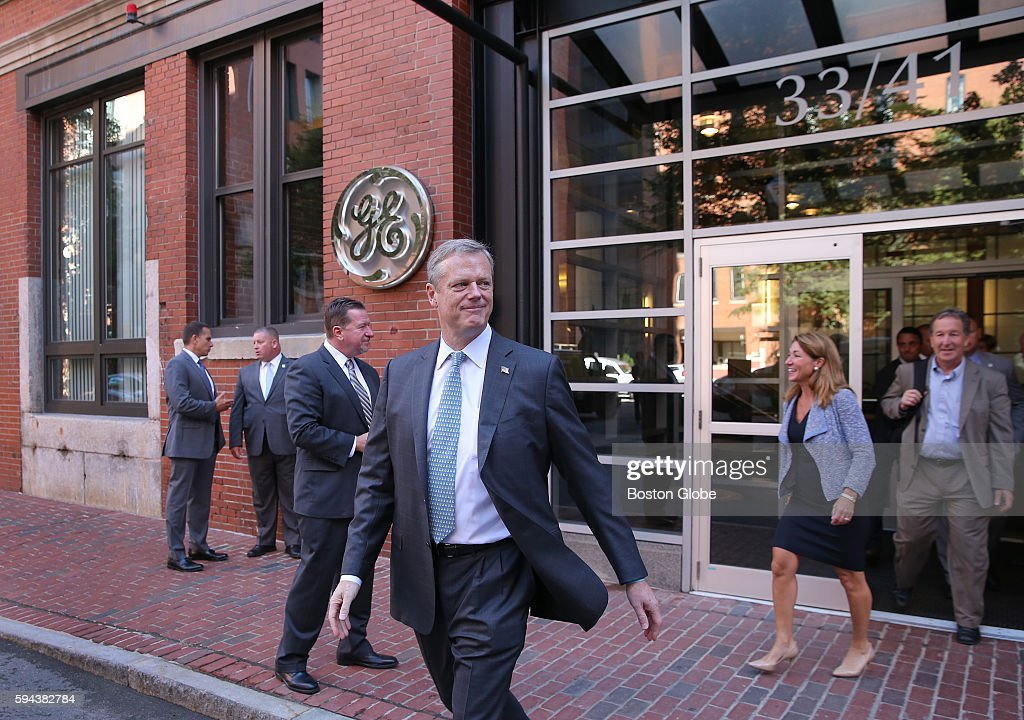 Gov Charles Baker leaves the entrance to GE General Electric has opened its new headquarters in Fort Point on Farnsworth Street in Boston Aug 22 2016