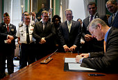Gov Charlie Baker signs a veterans benefits bill in his office at the State House in Boston July 14 2016 The legislation House Bill 4285 unanimously...