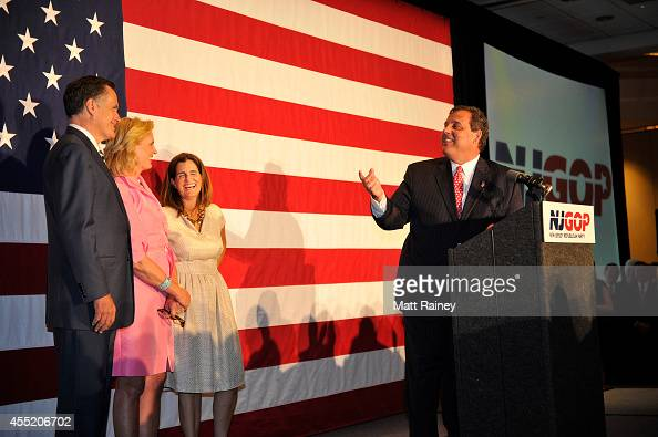 Gov Chris Christie looks over at former Republican presidential contender Mitt Romney as he addresses the audience during a birthday celebration on...
