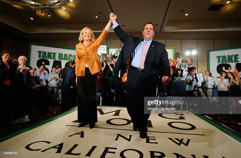 Gov. Chris Christie (R) of New Jersey holds the hand of California Republican Party gubernatorial candidate <a gi-track='captionPersonalityLinkClicked' href=/galleries/search?phrase=Meg+Whitman&family=editorial&specificpeople=767663 ng-click='$event.stopPropagation()'>Meg Whitman</a> during a campaign event on September 22, 2010 in Los Angeles, California. Christie is in California to campaign politically for the Republican candidate Whitman for California governor.