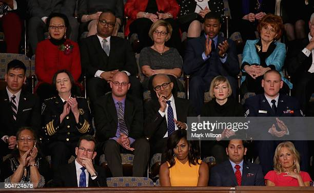Gov Dannel P Malloy of Connecticut A vacant seat for the victims of gun violence first lady Michelle Obama Naveed Shah of Springfield VA wife of US...
