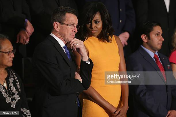 Gov Dannel P Malloy of Connecticut and first lady Michelle Obama talk before US President Barack Obama arrives before US President Barack Obama...