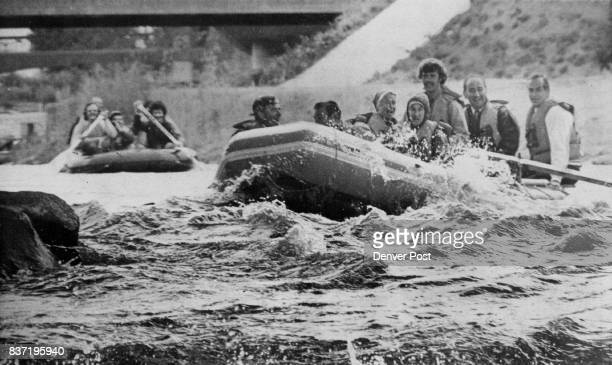 Gov Dick Lamm outfitted in safety gear above leads a contingent of kayakers and rafters down the South Platte River to kick off the Platte River...