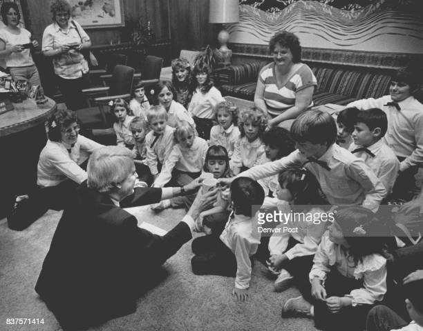 Gov Dick Lamm sits on the floor of the Gov's office with children from one room school house in Battlerock Colo He got gifts from the kids who solo...