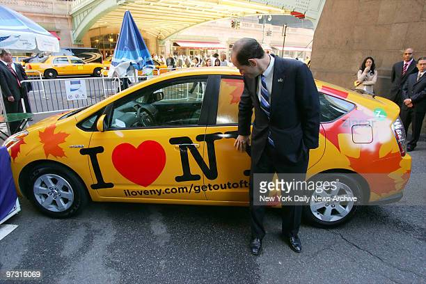 Gov Eliot Spitzer checks out an 'I Love New York' branded Zipcar outside Grand Central Terminal where he announced the state's partnership with Jet...