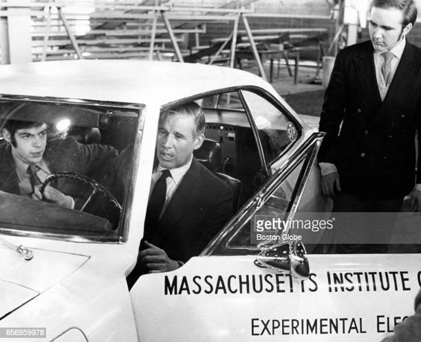 Gov Francis Sargent sits in the driver s seat of an experimental electric car dubbed Tech II that MIT students David A Saar left and William W Carson...