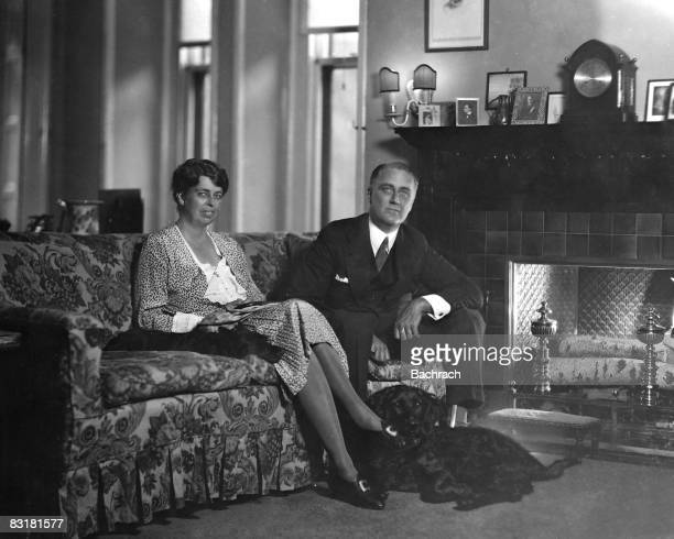 NY Gov Franklin Roosevelt sitting beside wife Eleanor w their dog at their feet in Executive Mansion New York 1929