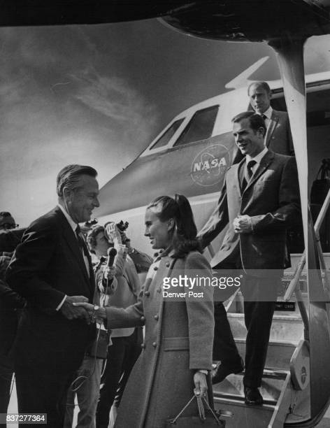 Gov John have greets Mrs Ann Scott as she deplanes at Peterson Field Behind her are her husband David Scott and AI Worden right Credit Denver Post