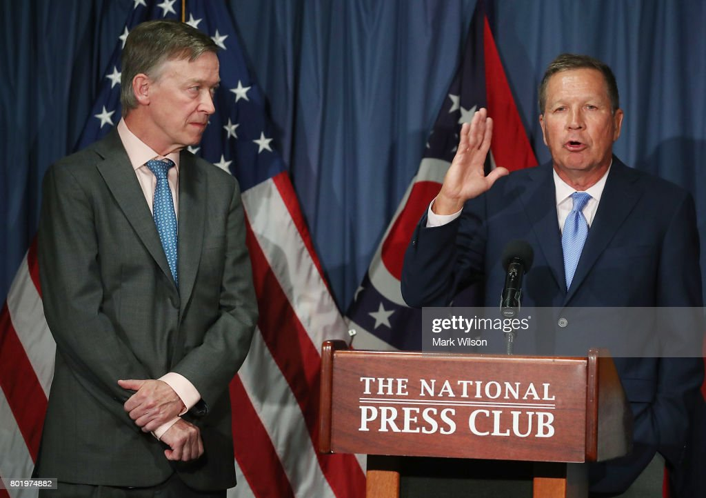 Gov. John Kasich (R-OH) (R) and Gov. John Hickenlooper (D-CO) participate in a bipartisan news conference to discuss the Senate health care reform bill at the National Press Club on June 27, 2017 in Washington, DC. The governors called on Senate Democrats and Republicans to work together to come up with a better health care bill.