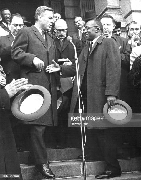 Gov John love is greeted with a handshake by the Rev Murphy C Williams of the New Hope Baptist Church at the rally Behind them are from left Rabbi...