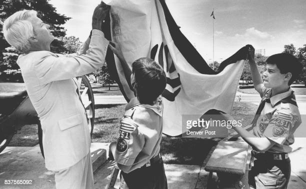 Gov Lamm Lends a hand to Boyscouts Andrew Kaiser and David Leidner during the raising of a new flag representing learning and liberty The flag was...