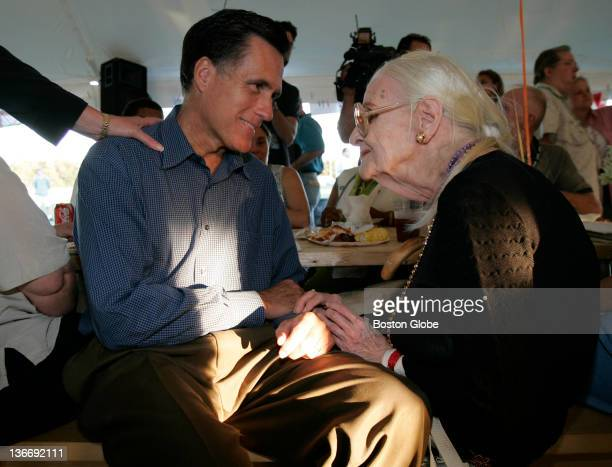 Gov Mitt Romney talks with Doris Jones of New Orleans during a BBQ dinner that was held for evacuees of Hurricane Katrina at Camp Edwards in Bourne...