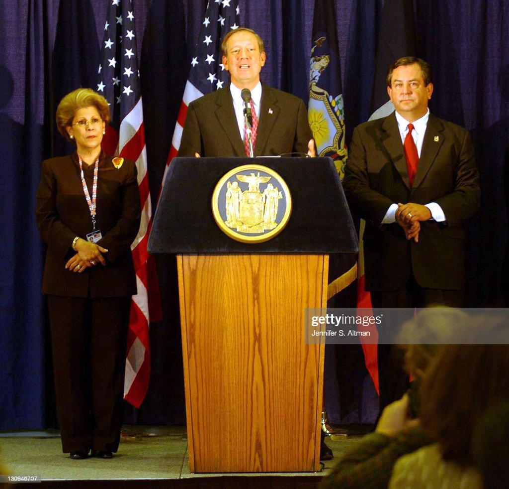 Gov. Pataki holds a press conference with NY State Health Commissioner Dr. Antonia Novella, left, and James Kallstrom, Director of the Office of Public Security at the Jacob Javits Center in Manhattan, NY. Pataki's office has been infected with Anthrax.