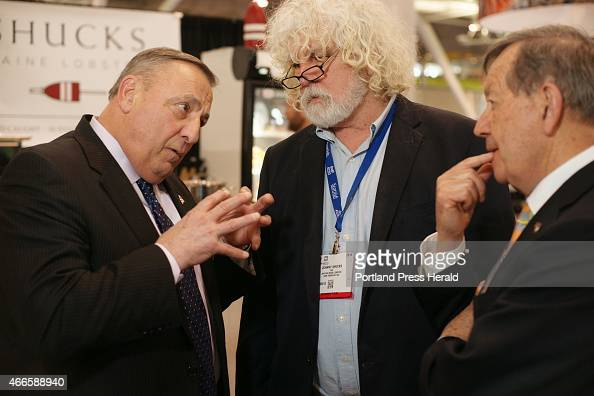 Gov Paul LePage speaks with John Hathaway owner of Shucks Maine Lobsters and Maine lobbyist Severin Beliveau at the the Seafood Expo North America...
