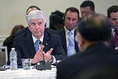 Gov Rick Snyder of Michigan attends a meeting of US and Chinese governors and Chinese President Xi Jinping to discuss clean technology and economic...