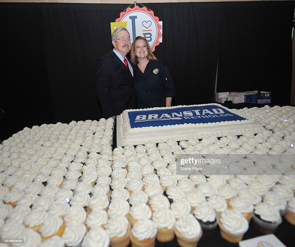 Gov. Terry Branstad (R-IA) stands in front of a cup cake display at his Birthday Bash October 25, 2014 in Clive, Iowa. Already distinguished as the states longest -serving governor, Branstad would become the longest -serving governor in U.S. history.were he to win the November 4th election.