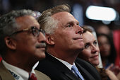 Gov Terry McAuliffe listens to speakers during the evening session on the second day of the Democratic National Convention at the Wells Fargo Center...