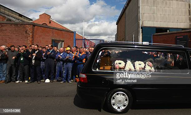 Govan shipyard workers pay tribute to shipyard and trade union icon Jimmy Reid as his hearse passes the Glasgow yard on its way to Govan Old Parish...