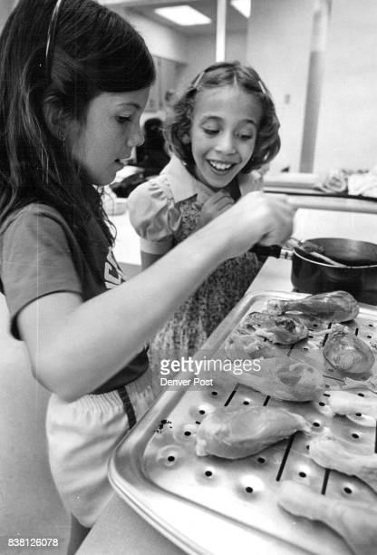 Gove Community School Laura Mitzner and Kira Wenger both 9 baste chicken pieces Credit Denver Post