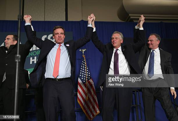 Govelect Terry McAuliffe celebrates with US Sen Tim Kaine US Sen Mark Warner and Lt Govelect Ralph Northam at an election night party at the Sheraton...