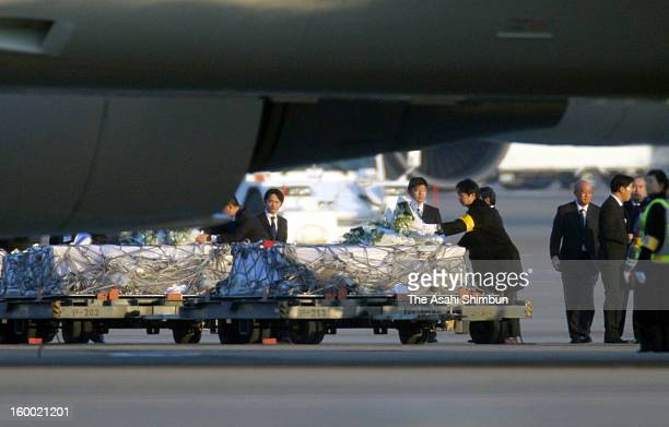 Goverment officials Japanese plant constructor JGC staffs offer flower banches to the coffins of the victims killed in the Algerian hostage crisis at...