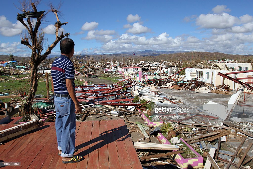 A governemnt teacher surveys the school destroyed by Typhoon Bopha, on December 8, 2012 in the town of Cateel, Davao Oriental province, Philippines. More than 500 people have been killed and scores of others remain missing after Typhoon Bopha, the strongest storm to hit the Philippines this year, pounded the region. The United Nations Office for the Coordination of Humanitarian Affairs reported that about 5.3 million people are affected and 533 are missing.