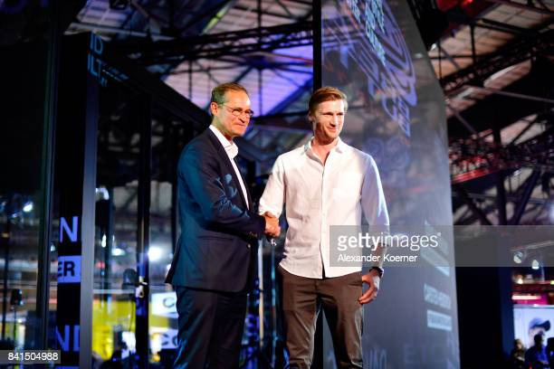 Governing Mayor of Berlin Michael Mueller is welcomed by Founder of Zalando David Schneider during the opening of Bread Butter by Zalando at arena...