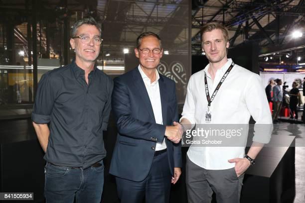 Governing Mayor of Berlin Michael Mueller is welcomed by VP Brand Marketing at Zalando Carsten Hendrich and Founder of Zalando David Schneider during...