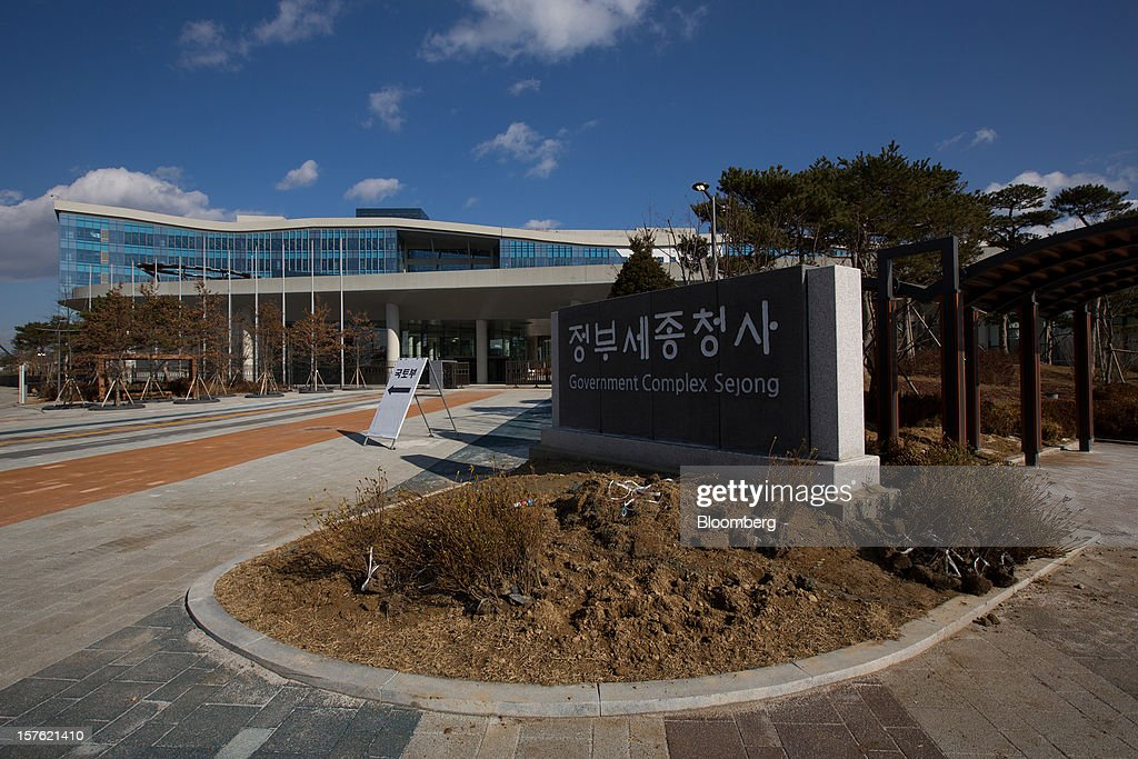 Government buildings stand in Sejong, South Korea, on Tuesday, Dec. 4, 2012. The construction of Sejong City 120 kilometers (75 miles) south of the capital fulfills the vision of the late President Roh Moo Hyun, who pledged to reduce the dominance of Seoul and pump money into a region courted for its swing voters. Photographer: SeongJoon Cho/Bloomberg via Getty Images