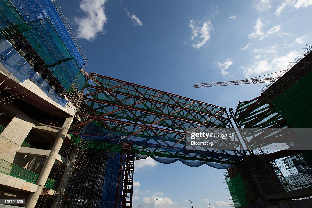 Government buildings stand under construction in Sejong, South Korea, on Tuesday, Dec. 4, 2012. The construction of Sejong City 120 kilometers (75 miles) south of the capital fulfills the vision of the late President Roh Moo Hyun, who pledged to reduce the dominance of Seoul and pump money into a region courted for its swing voters. Photographer: SeongJoon Cho/Bloomberg via Getty Images