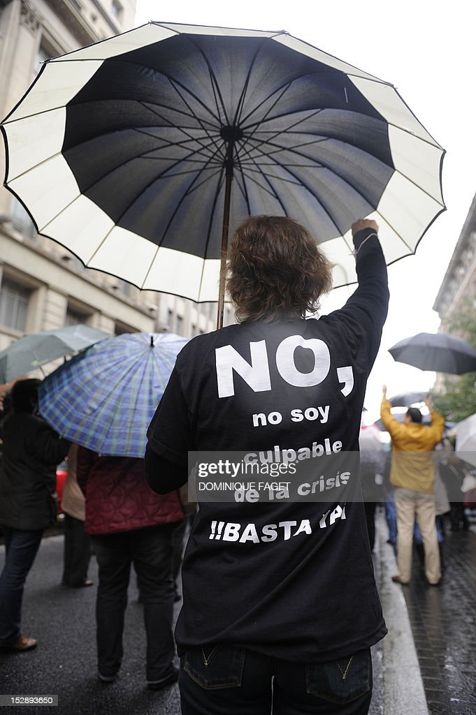 A government employee with a t-shirt thats reads 'No, I am not guilty of the crisis, stop' takes part in a demonstration against the Spanish government's latest austerity measures in the center of Madrid on September 28, 2012. Spain's government unveiled on September 27 a 2013 budget that tightens austerity even in the teeth of growing protests, easing the path to a widely expected sovereign bailout. Spanish inflation spiked to 3.5 percent on an annualised basis in September, its highest level since April 2011, provisional data from the national statistics institute Ine showed on September 28.