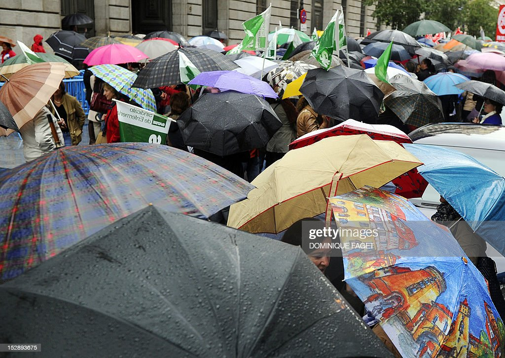 Government employees take part in a demonstration against the Spanish government's latest austerity measures in the center of Madrid on September 28, 2012. Spain's government unveiled on September 27 a 2013 budget that tightens austerity even in the teeth of growing protests, easing the path to a widely expected sovereign bailout. Spanish inflation spiked to 3.5 percent on an annualised basis in September, its highest level since April 2011, provisional data from the national statistics institute Ine showed on September 28.
