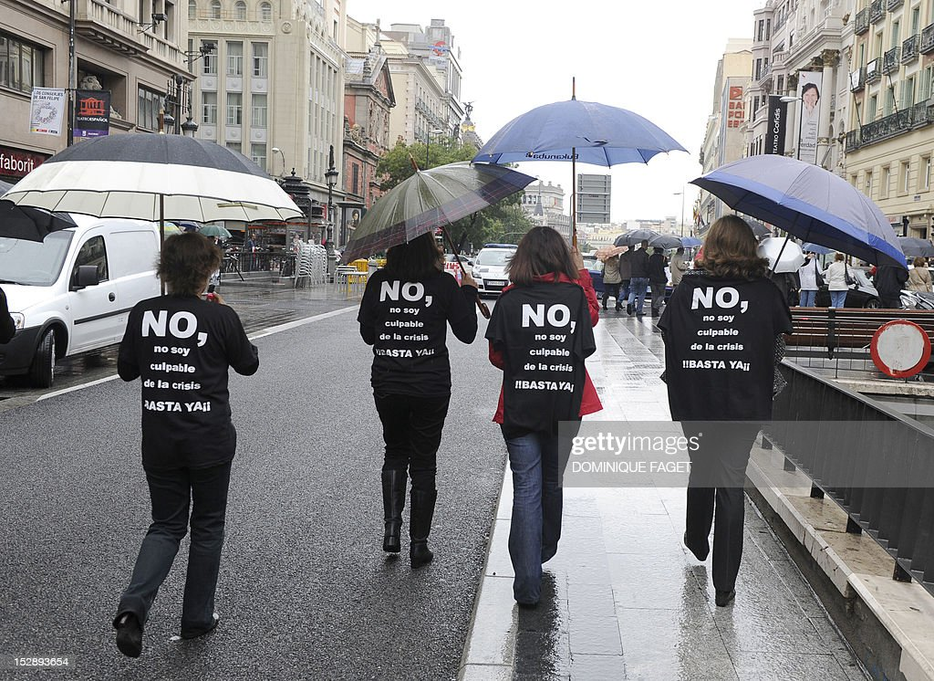 Government employees with t-shirts thats read 'No, I am not guilty of the crisis, stop' take part in a demonstration against the Spanish government's latest austerity measures in the center of Madrid on September 28, 2012. Spain's government unveiled on September 27 a 2013 budget that tightens austerity even in the teeth of growing protests, easing the path to a widely expected sovereign bailout. Spanish inflation spiked to 3.5 percent on an annualised basis in September, its highest level since April 2011, provisional data from the national statistics institute Ine showed on September 28.