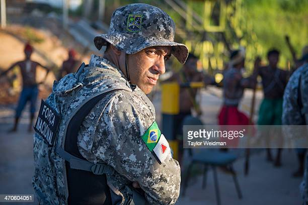 Government forces faced off with indigenous Munduruku protesters during an occupation of the Belo Monte Dam On May 27th an indigenous group made up...