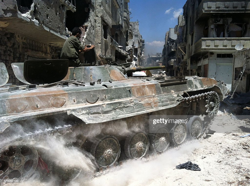 A government forces tank is seen in the al-Khalidiyah neighbourhood of Syria's central city of Homs on July 28, 2013. Government forces bolstered by Lebanese Shiite militiamen were poised to retake the largest rebel-held district of Syria's third city Homs, a watchdog and state media said.