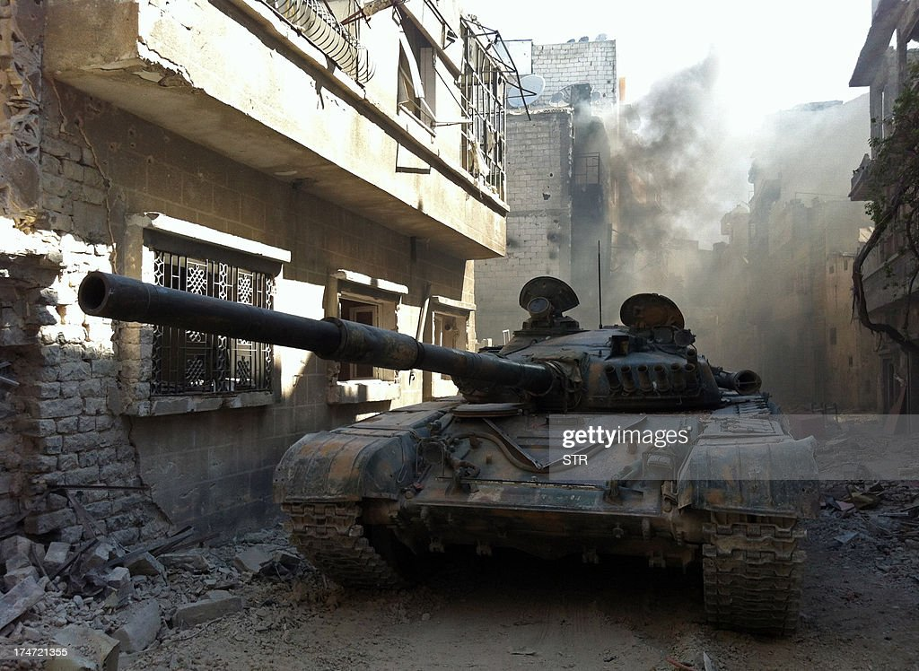 A government forces tank is seen in the Khalidiyah neighbourhood of Syria's central city of Homs on July 28, 2013. Government forces bolstered by Lebanese Shiite militiamen were poised to retake the largest rebel-held district of Syria's third city Homs, a watchdog and state media said.