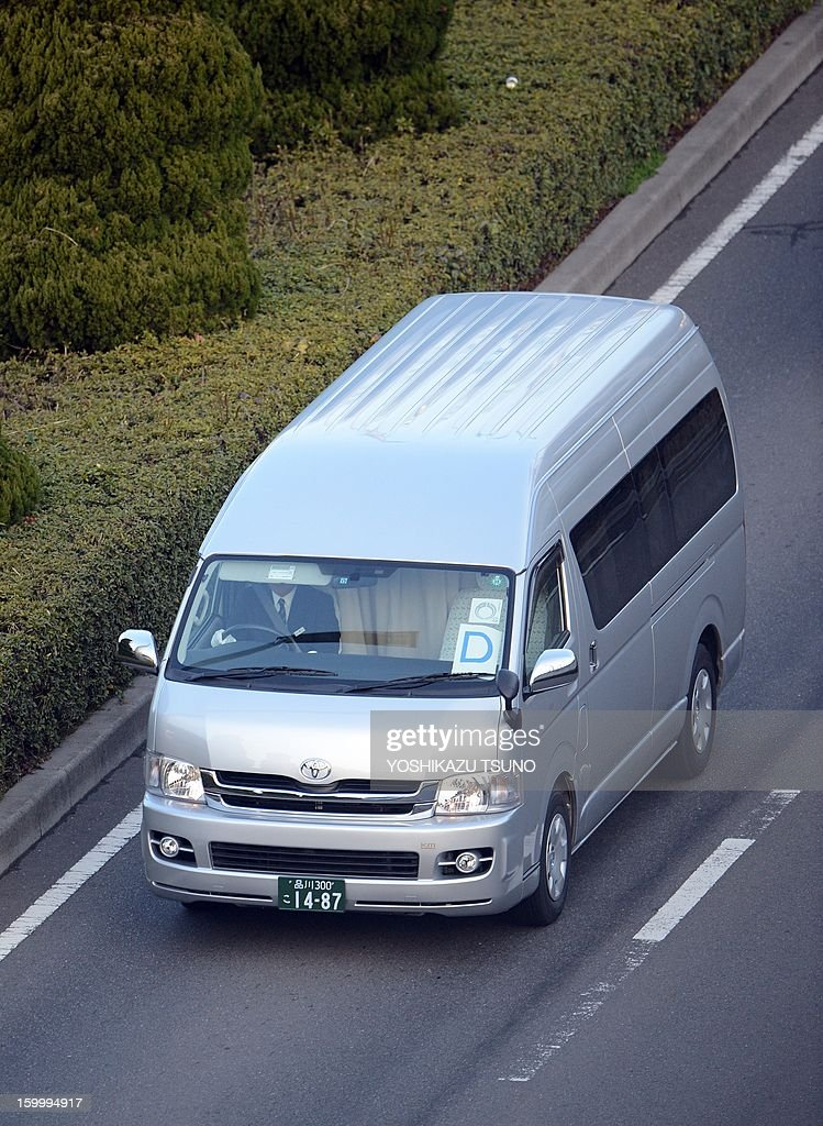 A government hired van leaves the Haneda airport in Tokyo on January 25, 2013 following the return of a plane carrying seven survivors of the Algerian hostage crisis, along with nine of the country's ten dead. Japan's government plane carrying seven survivors of the Algerian hostage crisis, along with nine of the country's ten dead, arrived back in a shell-shocked Japan on January 25. AFP PHOTO / Yoshikazu TSUNO
