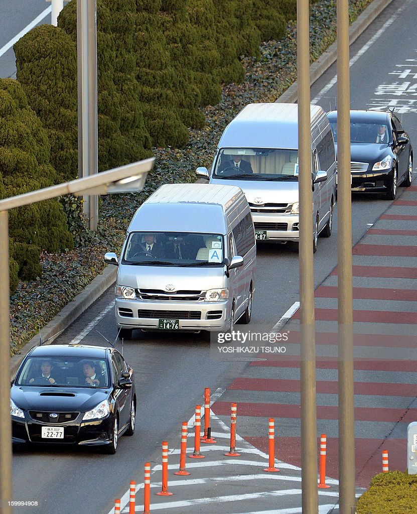 Government hired vans (silver), leave the Haneda airport in Tokyo on January 25, 2013 following the return of a plane carrying seven survivors of the Algerian hostage crisis, along with nine of the country's ten dead. Japan's government plane carrying seven survivors of the Algerian hostage crisis, along with nine of the country's ten dead, arrived back in a shell-shocked Japan on January 25. AFP PHOTO / Yoshikazu TSUNO