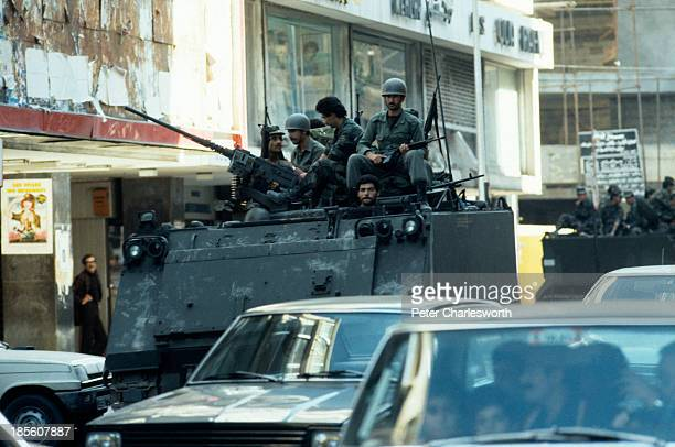 Government Lebanese Army troops patrol down Al Hamra street West Beirut's main thoroughfare and shopping street during a lull in the civil war