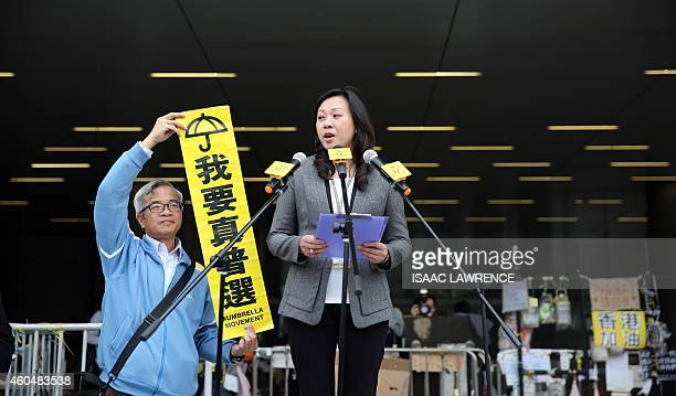 A government official advises prodemocracy protesters that a deadline had ended to leave an area in front of the legislative council building in the...