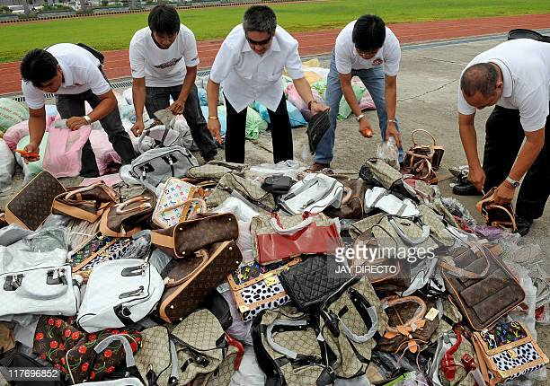Government officials from different agencies destroy 8 million USD worth of counterfeit shoes bags medicine books sunglasses and digital video discs...