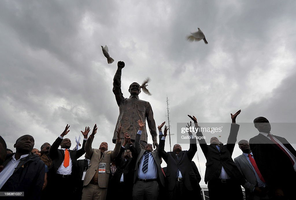 Government officials release doves as the statue of Madiba is unveiled at Naval Hill on December 13, 2012, in Bloemfontein, South Africa.