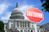 Government Shutdown concept: Stop sign in front of US Capital Building++Image of Capital was taken by photographer ++